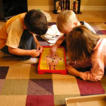 Children playing Operation
